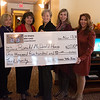 (from left) Chantille Wooten, Ronald McDonald House volunteer, Jacci Pim, volunteer, Annette Thurston, executive director of the Ronald McDonald House, Valerie Doerr, 100 Women Who Care committee member, Tara Horinek, associate director of the Ronald McDonald House, and Cindy Starrett, 100 Women Who Care committee member, attend Tuesday's check presentation from 100 Women Who Care of Jasper/Newton County to the Ronald McDonald House. The $1,500 donation will be used by the House to replace computers used by occupants. <br /> Globe | Roger Nomer