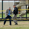Investigators place evidence markers at the scene of an officer-involved shooting early Friday afternoon in the playground of the Springhill Apartments near 21st and McCoy streets.<br /> Globe | Laurie Sisk