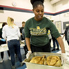 Missouri Southern Zeta Tau Alpha sorority sister jurnee Adams delivers two more turkeys for deboning on Thursday night at the Salvation Army as her sorority helps prepare the food for 400 to 500 people on Thanksgiving Day.<br /> Globe | Laurie SIsk