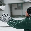 Levi Arias, 12, tosses a snowball in the air while playing with his family in Webb City on Monday.<br /> Globe | Roger Nomer