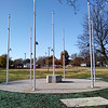 Seven flag poles encompass the concrete pad on the ongoing construction project of Carl Junction's first Veteran Memorial. The memorial will also include bronze medallions and plaques, as well as four park benches. Kimberly Barker/JoplinGlobe