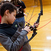 Phillip Trout, seventh grader at Lamar Middle School, looks at a bow donated by the Missouri Department of Conservation on Wednesday.<br /> Globe | Roger Nomer