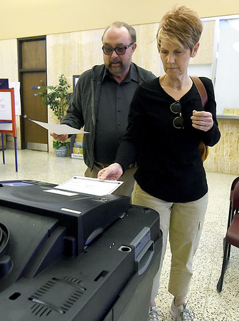 From the left: Mark and Mary Hensley cast their ballots on Prop B on Tuesday at the Donald E. Clark Justice Center, Election officials reported a good turnout for an off-year election.<br /> Globe | Laurie Sisk