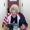 Van Stufflebeam wears a patriotic outfit as she helps voters sign in at The Civic in Neosho on Tuesday.<br /> Globe | Roger Nomer