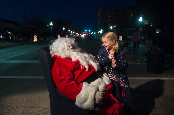 Halle Yeager, 6, Carterville, tells Santa what she wants for Christmas on Monday in downtown Joplin. Globe | Roger Nomer