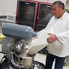 Keith McDonald cooks for his cinnamon roll delivery business on Monday at the Advanced Training and Technology Center kitchen.<br /> Globe | Roger Nomer