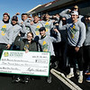 Members of Missouri Southern's Kappa Alpha fraternity flex their muscles with MDA ambassador MiKayla Berry, center, after the 2019 Pigskin run at Carnie Smith Stadium before the start of the Pittsburg State/MSSU football game. KA raised $3.000 for MDA, performing funraiser auch as working security at a Chiefs game. Pictured to Berry's right is KA President Rylee Hartwell.<br /> Globe | Laurie SIsk