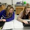 Kaydence Lee and Brooke Sommer, freshmen at Sarcoxie High School, work during biology class on Friday at Sarcoxie High School.<br /> Globe | Roger Nomer
