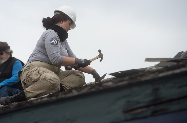 Brionna May, from Amarillo, Texas, works on a roof at Royal Heights Baptist Church on Monday during an Americorps project.<br /> Globe | Roger Nomer