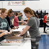 Some of the more than 30 Missouri Southern Zeta Tau Alpha sisters help prepare turkey meat on Thursday night for the Salvation Army's annual Thanksgiving dinner. <br /> Globe | Laurie SIsk