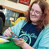 Linda Switzer, a Missouri Southern sophomore from Joplin, paints her boomerang on Wednesday at the Billingsly Student Center. The event was held as part of the Oceanic Semester at the university.<br /> Globe | Roger Nomer