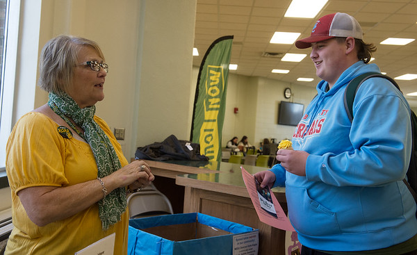 Debbie Fort, director of Project Stay, talks with David Wooden, a Missouri Southern freshman from Webb City, about Project Stay on Friday at MSSU.<br /> Globe | Roger Nomer