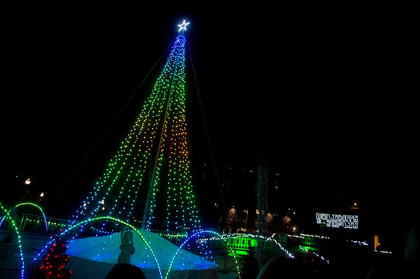 The Christmas tree is lit in Spiva Park during the annual lighting ceremony in Joplin on Monday.<br /> Globe | Roger Nomer