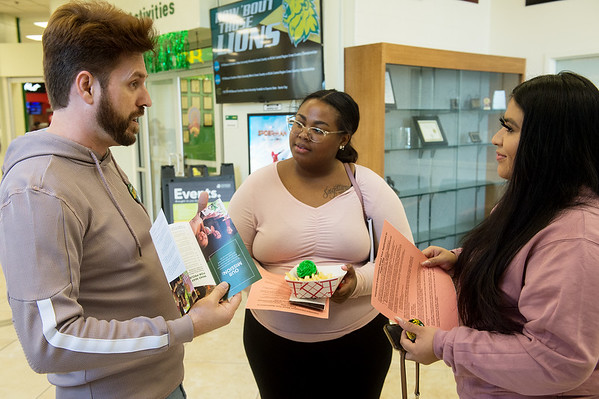 Eddie Kirkendall, academic advisor and career couselor with Project Stay, talks with Marissa Athomo, a Missouri Southern freshman from Joplin, center, and Jennifer Mejia, a freshman from Carthage, about Project Stay on Friday at MSSU.<br /> Globe | Roger Nomer
