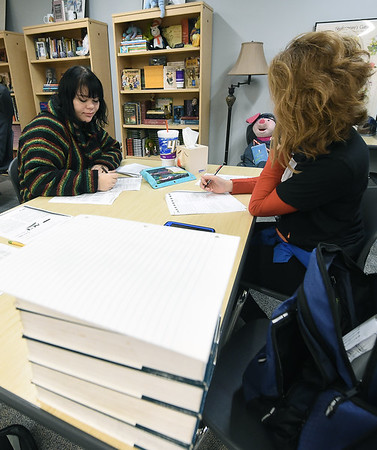 From the left: Sarah Boggs and Sara Grant take practice ACT tests in reading on Wednesday during an ACT test prep class at Joplin High School.<br /> Globe | Laurie Sisk