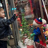 Grayson McBride, 2, Joplin, checks out the decorated windows at Urban Art Gallery on Monday in downtown Joplin.<br /> Globe | Roger Nomer