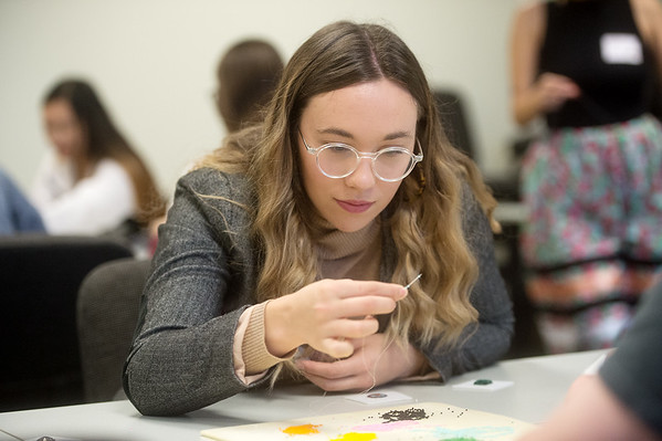 """Anna Ohmart, a Missouri Southern senior from Kansas City, Mo., beads during Thursday's """"The Whole Story:  A Decolonial Cross-Cultural Day Institute and Scholarship Fundraiser"""" at MSSU.<br /> Globe 