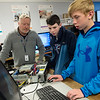 (from left) Bryce Langley, computer science instructor at Crowder College, talks about BIOS with Riley Conway and Reece Cobb, both eighth graders at Neosho Junior High School on Tuesday at the Dell Reed Technical Education Center at Crowder College.<br /> Globe | Roger Nomer