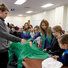 Kat Gries, left, tests girls' powers of observation in a memory exercise during the Missouri Southern Women in Science Club's STEM event for area scouts.<br /> Globe | Lurie Sisk