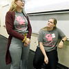 From the left: Missouri Southern Women in Science Club Treasurer Raven Paige and President Katie Paine talk about sharing their love of science with young girls during the club's STEM event for area scouts.<br /> Globe | Lurie Sisk