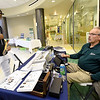 From the left: Bronx, N.Y. senior and December graduate Jamal Tasfay looks over the selection of class rings and necklaces as Jostens representative William Holl assists during Missouri Southern's Grad Expo on Wednesday at MSSU's Hearnes Hall.<br /> Globe | Laurie SIsj