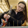 McKinzie Boevins, eighth grader at Neosho High School, works on her hammering technique on Tuesday at the Dell Reed Technical Education Center at Crowder College.<br /> Globe | Roger Nomer