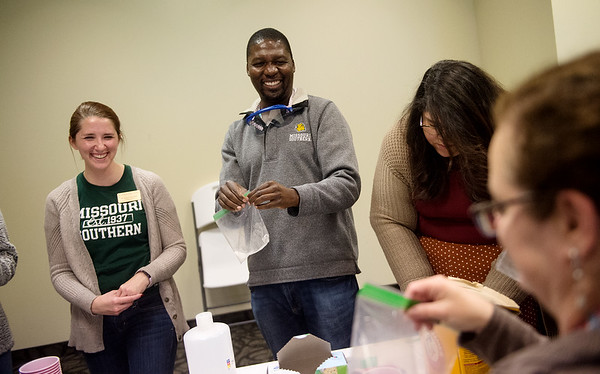 """Shayna Burchett and Bornface Gunsaru, assistant professors of chemistry at Missouri Southern, lead an experiment during their decolonizing science session at Thursday's """"The Whole Story:  A Decolonial Cross-Cultural Day Institute and Scholarship Fundraiser"""" at MSSU.<br /> Globe   Roger Nomer"""
