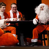 """A trio of Santas commiserate after a long day of work during rehearsals for the Webb City High School production of """"Elf,"""" which opens Thursday night at WCHS. From the left: Andrew Beard, Logan VanMoose and Ana Brown. The cast and crew are collecting toys to benefit children.<br /> Globe 