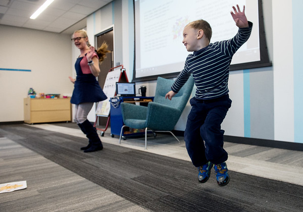 Seamus O'Connell, 4, shakes his sillies out during Fun for 4's and 5's storytime with Shelley Keezer, children's assistant, at the Joplin Public Library on Wednesday.<br /> Globe | Roger Nomer