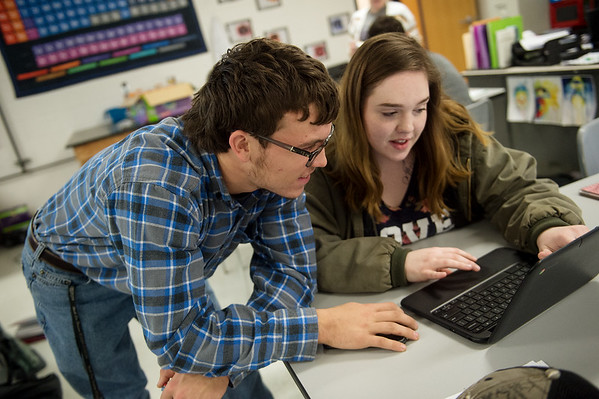 Dylan Heckmaster and Natalie Clark, juniors at Sarcoxie High School, work on a project in biology class at Sarcoxie High School on Friday.<br /> Globe   Roger Nomer