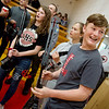 Liberal high school and middle school students, including Mason Eyeler, eighth grade, receive a donation of archery equipment from the Missouri Department of Conservation on Wednesday at Liberal High School.<br /> Globe | Roger Nomer