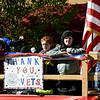 Pack 17 Cub Scouts wave from their float during the The 32nd Annual Community Veterans Day Parade on Saturday in downtown Joplin.<br /> Globe | Laurie SIsk
