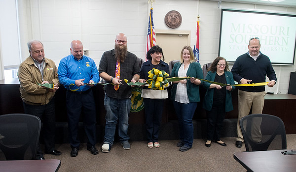 Staff cut the ribbon on the new mock courtroom at Missouri Southern State University on Tuesday.<br /> Globe   Roger Nomer