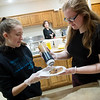 Sydnei Neill, 17, left, and Leah Hilsenbeck, 17, prepares pancakes during Friday's Black Friday Pancake Feed at Wildwood Baptist Church. The pancake fundraiser was held by seniors in the Home Schoolers Network to raise money for a senior trip.<br /> Globe | Roger Nomer