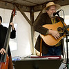 From the left: Ozarkians Mary and Larry Matfield, of the Red Bridge bluegrass band, entertain guests at a special Thanksgiving market on Wednesday at the Webb City Farmers mrket.<br /> Globe | Lurie Sisk
