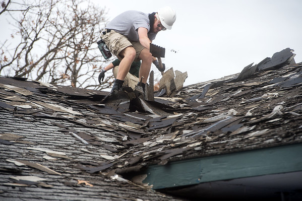 Sterling Russell, from Half Moon Bay, Calif., works on a roof at Royal Heights Baptist Church on Monday during an Americorps project.<br /> Globe | Roger Nomer
