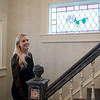 Courtney Coleman talks about the stained glass windows inside La Rose Blanche during an interview on Friday.<br /> Globe | Roger Nomer