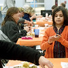 Seven-year-old volunteer Sophia Aiken tends to guests needs during the community Thanksgiving dinner on Thursday at the Salvation Army.<br /> Globe | Laurie Sisk