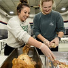 From the left: Zeta Tau Alpha sisters Avery Brown, of Cassville and Kaitlyn Adams, of Jasper, join more than 30 of thier sorority sisters on Thursday night as they help prepare turkey meat for the Salvation Army's annual Thanksgiving dinner. <br /> Globe | Laurie SIsk