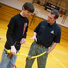 Andy Rhodes, conservation educator with the Missouri Department of Conservation, talks with Caleb Vore, freshman at Liberal High School, about donated archery equipment on Wednesday at the school.<br /> Globe | Roger Nomer