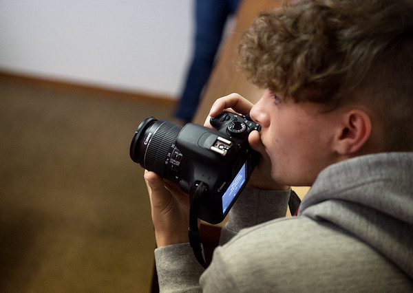 Wesley Goodman, a senior at Carthage High School, looks for an opportunity to take a photo during the annual Journalism Workshop Day at the Joplin Globe on Monday. Students from area high schools visited the newspaper to learn about careers in journalism.<br /> Globe | Roger Nomer