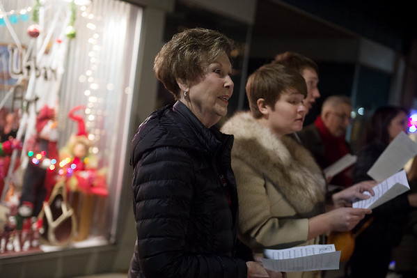 Karen Buchanan, left, and Emily Larson sing a carol with the Heartland Opera Theatre on Monday in downtown Joplin. Globe | Roger Nomer
