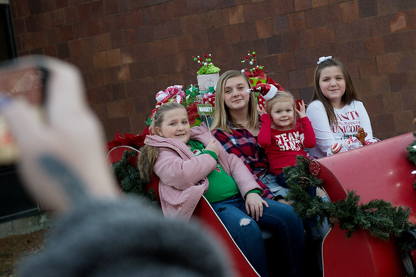 (from left) Averie, 11, Morgan, 13, Vanna, 3, and Presley, 9, McKeehan, of Galena, pose for a holiday photo in downtown Joplin on Monday. Globe | Roger Nomer