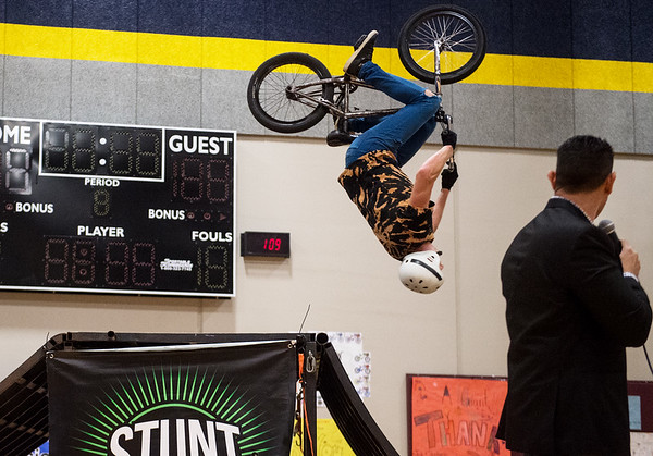 John Andrus, midwest director of the Stunt Dudes, performs a flip for students at Cecil Floyd Elementary during the Joplin Schools All Kids Bike presentation on Tuesday.<br /> Globe | Roger Nomer