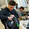 Cody Berry, a Missouri Southern senior from Blue Springs, Mo., puts a Project Stay button on his backpack on Friday at MSSU.<br /> Globe | Roger Nomer