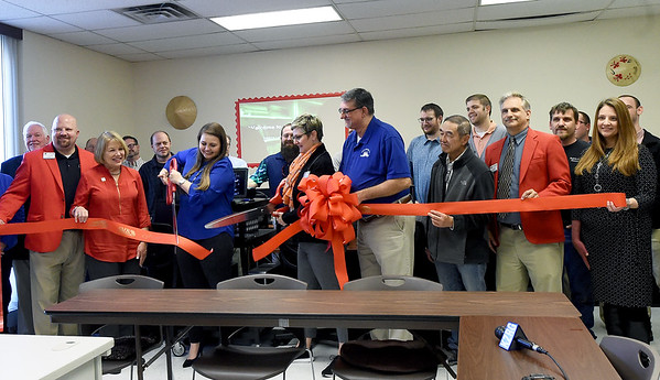 Representatives from Joplin NALA, businesess who donated hardware or technical expertise and members of the Carthage and Joplin Area Chambers of Commerce gather for the official opening of NALA's computer lab on Tuesday at NALA. The agency now has 15 working computers to help their clients in their quest for better literacy.<br /> Globe   Laurie Sisk