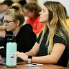 From the left: Overland Park, Kan. sophomore Lilly Motti and Bixby, Okla. sophomore Madalynn Dees listen during Missouri Southern biology professor Victoria Rhoades'  large class on Wednesday in Reynolds Hall.<br /> Globe | Laurie Sisk