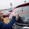 Joplin High dance team member Ellie Benfield, freshman, decorates a car window for a fundraiser before Joplin's state semnifinal on Friday at Joplin High School.<br /> Globe | Roger Nomer