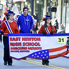 The East Newton High School Marching Patriots entertain the crowd during The 32nd Annual Community Veterans Day Parade on Saturday in downtown Joplin.<br /> Globe | Laurie SIsk