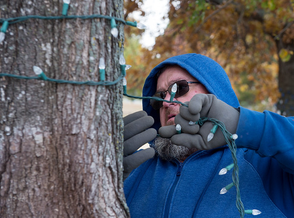 James Herron, with Joplin Parks and Rec, puts up Christmas lights at Campbell Parkway on Thursday afternoon.<br /> Globe | Roger Nomer